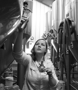 Our Quality Manager Katie takes a sample of beer for testing.
